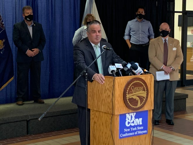 Binghamton Mayor Richard David speaks at the New York Conference of Mayors media conference Wednesday, Oct. 7, 2020 at Syracuse City Hall. David said Thursday he tested positive for COVID-19 after the event.