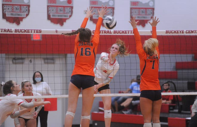 Buckeye Central's Lauren Mann smashes a ball through Galion's Hailey Young (16) and Kayla Hardy (7).