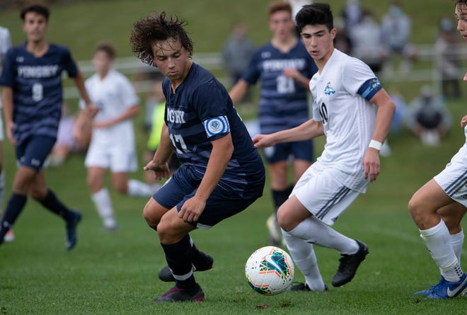 Pingry Tristan Sampedro and Gill St Bernard Adam Berrocal chase a loose ball during second half action. Gill St. Bernards boys soccer edges out Pingry 2-1 in Basking Ridge NJ on October 7, 2020.