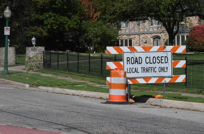 Barriers are seen blocking traffic on Moores River Drive that leads toward the cul-de-sac near the Governor's Mansion on Oct. 8, 2020, in Lansing, Mich.  Six people have been charged with allegedly plotting to kidnap Michigan Democratic Gov. Gretchen Whitmer at her vacation home. That's according to a criminal complaint unsealed Thursday.