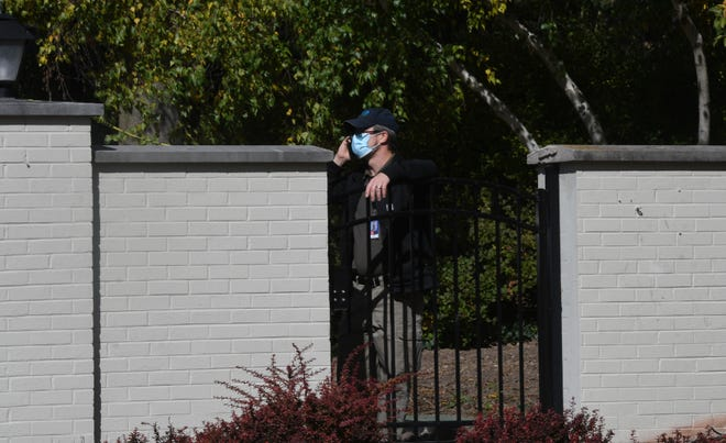A man was seen just inside the Governor's mansion on Oct. 8, 2020. due to a recent threat, security measures such as a newly placed metal fence surround the perimeter of the property.
