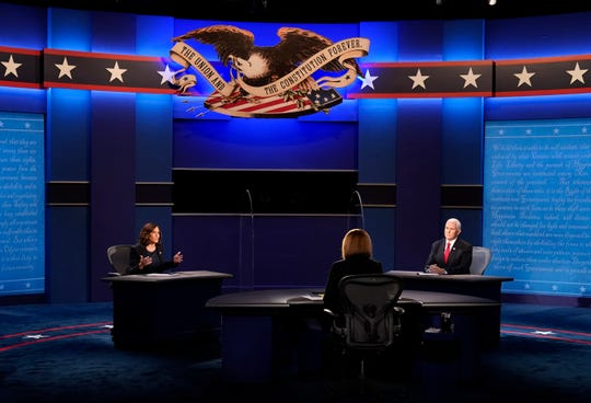Vice President Mike Pence listens as Democratic vice presidential candidate Sen. Kamala Harris, D-Calif., makes a point during the vice presidential debate Wednesday, Oct. 7, 2020, at Kingsbury Hall on the campus of the University of Utah in Salt Lake City.