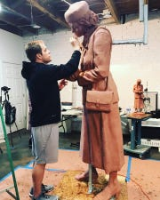 Greenville artist Charles Pate Jr. works on his sculpture of Lila Mae Brock. The statue, now finished, will go in a plaza near Unity Park.