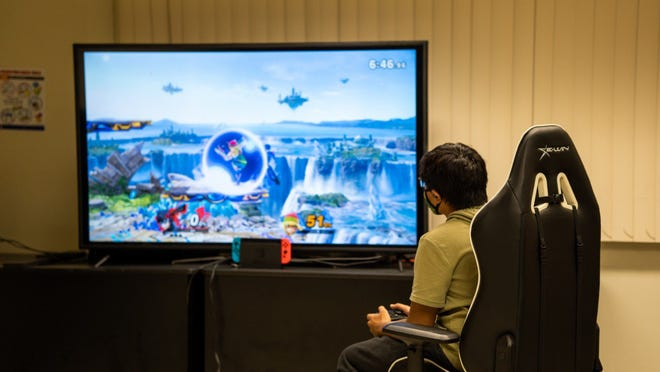 A University of Guam student tries out for the first-ever Triton Esports team in August. The team has since established a roster and is practicing for an interscholastic tournament later this month.