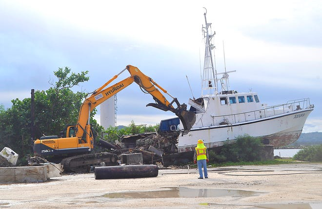 The Port Authority of Guam and the Department of Public Works on Oct. 7 demolished and removed a derelict vessel at Seaplane Ramp. It had been abandoned for years by its original owner at Agat Marina.