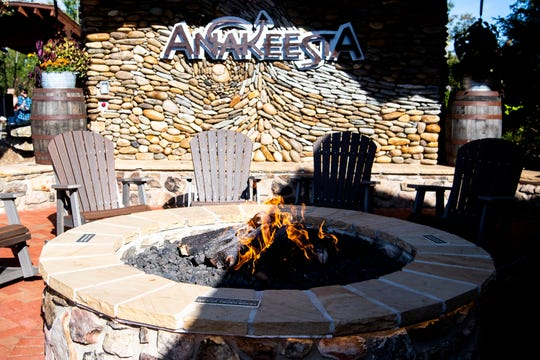 Rocking chairs surround a fire pit with views of the Smoky Mountains at the new Black Bear Village expansion now open at Anakeesta in Gatlinburg on Thursday, October 8, 2020.