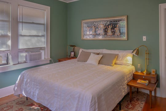Walls painted a soft green set a soothing atmosphere in the master bedroom.