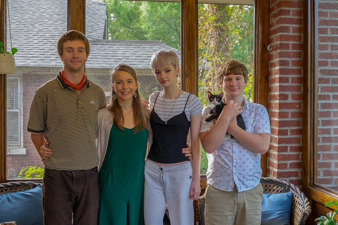 From left, Dylan, Olivia, Bella, and Henry Lomax (holding Jager) love their new home.