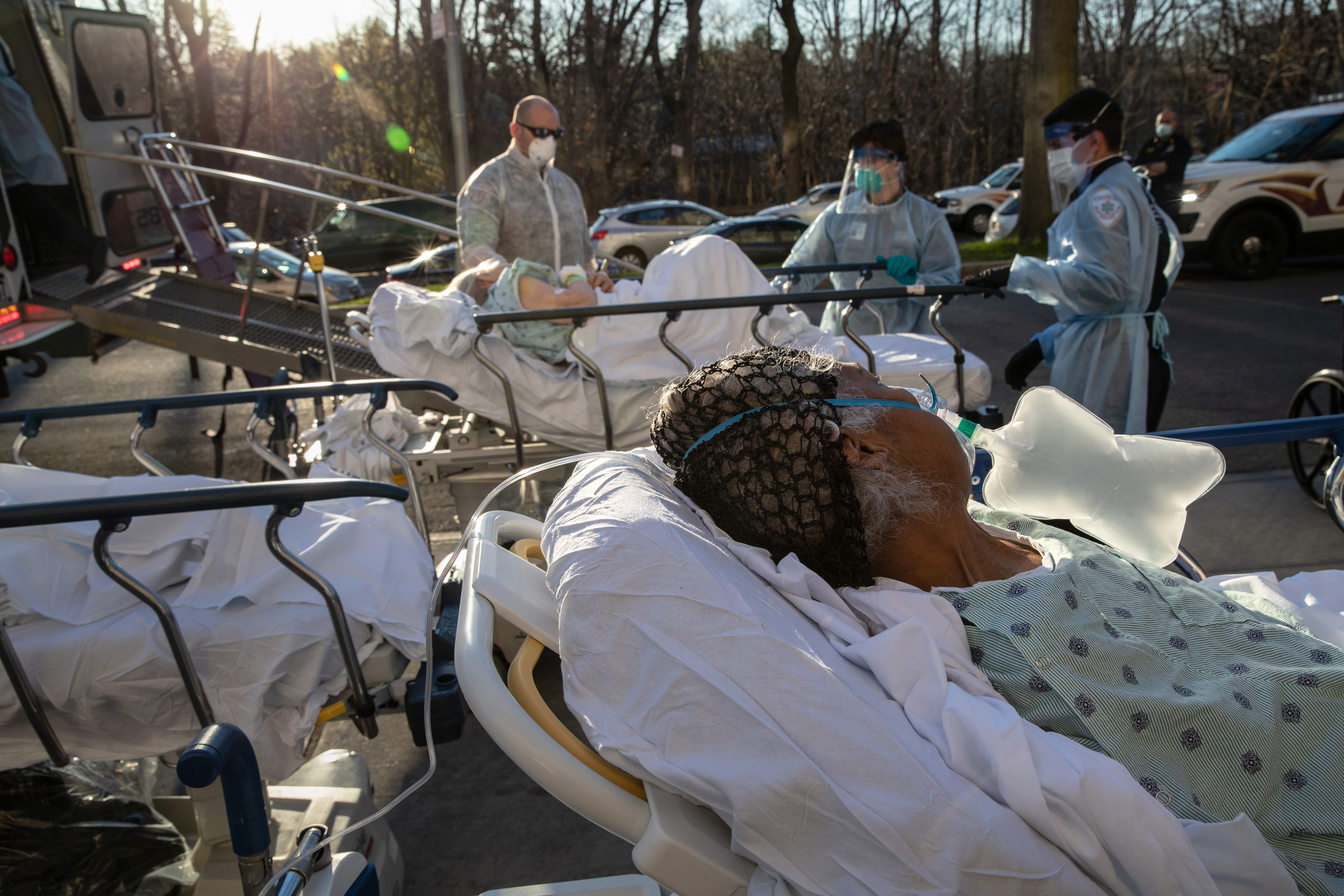 COVID-19 patients arrive at the Wakefield Campus of the Montefiore Medical Center on April 6 in the Bronx borough of New York City. The patients were being transferred from the Einstein Campus of Weilerl Hospital, also a Bronx Montefiore hospital.