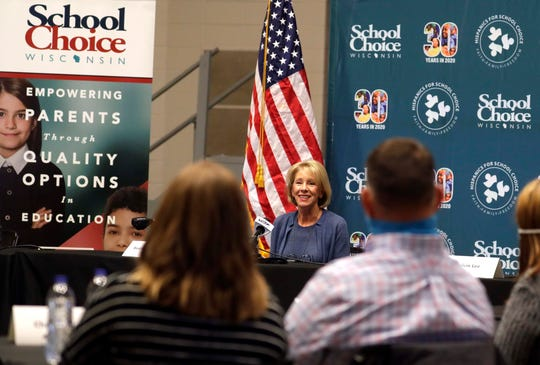 Secretary of Education Betsy DeVos speaks with parents about schools operating during COVID-19 at the Waukesha Expo Center on Thursday.