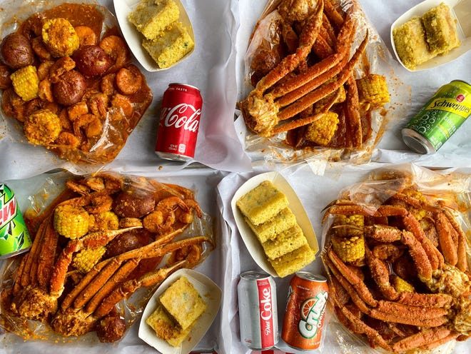 Lowcountry, a Chicago restaurant that chose Milwaukee for its third location, serves seafood boil in a bag, a dining trend popular with customers.