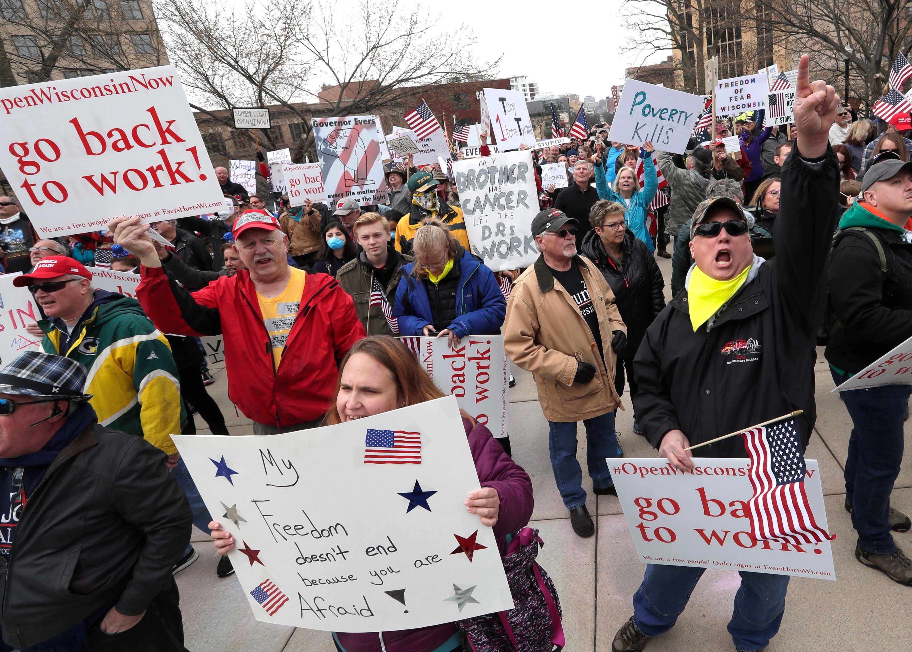 Protesters at the Wisconsin Capitol on April 24 call for the state to reopen, saying a stay-at-home order that closed schools, churches and non-essential businesses to prevent the spread of the coronavirus was causing economic damage.