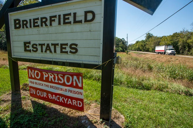 Neighbors post signs opposing a newly proposed prison in Brierfield, Ala., on Monday, Oct. 5, 2020. Brierfield is one of the proposed sites for a new state prison.