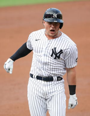 SAN DIEGO, CALIFORNIA - OCTOBER 08:  Luke Voit #59 of the New York Yankees celebrates after hitting a solo home run against the Tampa Bay Rays during the second inning in Game Four of the American League Division Series at PETCO Park on October 08, 2020 in San Diego, California.