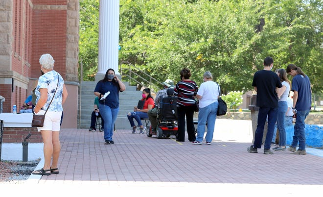 Voters waited outside the Luna County Clerk's Office on Thursday to cast an early-voting  ballot for the 2020 General Election. Lines have been forming at the clerk's office since early voting began on Tuesday, Oct. 6.