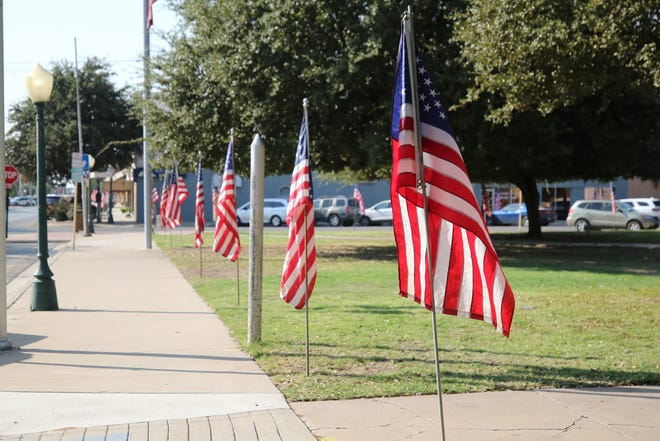 Flags are erected to celebrate Columbus Day, Oct. 8, 2020 in downtown Carlsbad.