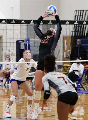 Mercy senior Julia Bishop sets up a teammate against Marian.