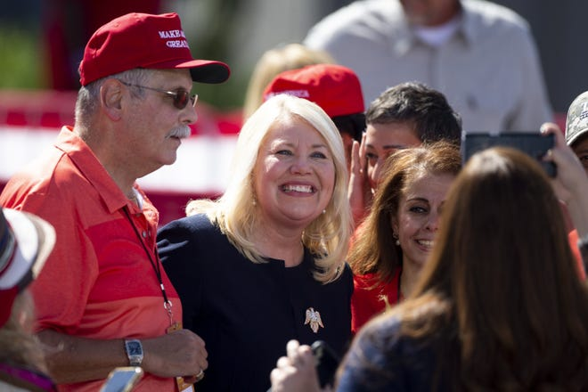 Rep. Debbie Lesko, R-Ariz., takes photo with  supporters before Vice President Mike Pence speaks at a rally at TYR Tactical in Peoria, Ariz. on Oct. 8, 2020.