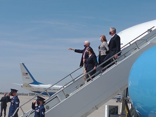 Vice President Mike Pence, his wife Karen Pence, Marsha Mueller, and Carl Mueller, parents of Kayla Mueller, descend the steps of Air Force Two on arrival in Phoenix on Oct. 8, 2020.