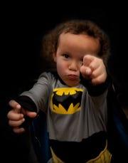 Zaadii dressed up in his favorite Batman costume.