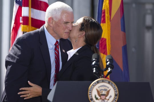 Second lady Karen Pence greets her husband, Vice President Mike Pence, at a rally at TYR Tactical in Peoria, Ariz. on Oct. 8, 2020.