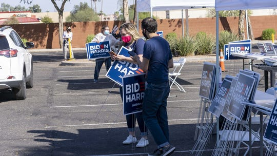 "Former Vice President Joe Biden and Sen. Kamala Harris deliver remarks and embark on a ""Soul of the Nation"" bus tour. At the same time, Biden supporters pick up yard signs outside Carpenters Local Union 1912 located at 4547 W. McDowell Road  in Phoenix on Oct. 8, 2020."