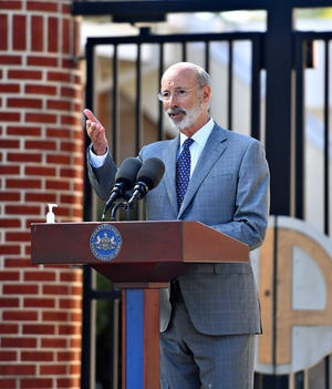 Gov. Tom Wolf speaks about affordable care act coverage at Hannah Penn K-8 School in York City, Thursday, Oct. 8, 2020. Dawn J. Sagert photo