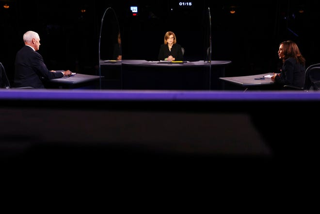 Vice President Mike Pence listens as Democratic vice presidential candidate Sen. Kamala Harris, D-Calif., speaks during the vice presidential debate Wednesday, Oct. 7, 2020, at Kingsbury Hall on the campus of the University of Utah in Salt Lake City. (Justin Sullivan/Pool via AP)