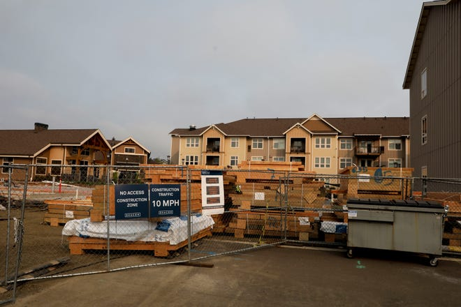 Construction crews work on an expansion to Dallas Retirement Village in Dallas, Oregon on Wednesday, Oct. 7, 2020.