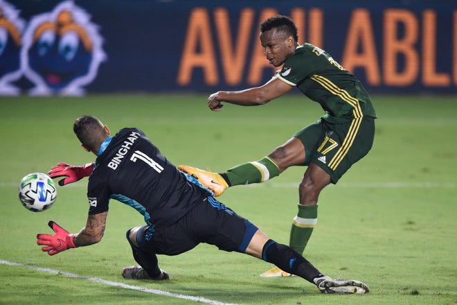 Oct 7, 2020; Carson, California, USA; Portland Timbers forward Jeremy Ebobisse (17) shoots the ball for a goal past LA Galaxy goalkeeper David Bingham (1) during the second half at Dignity Health Sports Park.