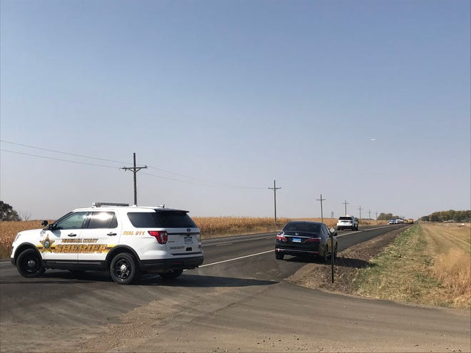 Authorities block off Highway 42 west of Sioux Falls after two people died in a crash on Thursday.