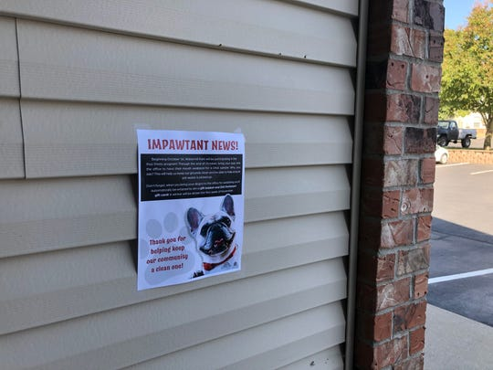 No dog-walkers were out at Watermill Park Apartments in Springfield at midday on Oct. 2, 2020, but a poster advertised Poo Prints, a new service being used by the complex to DNA test dogs, making it possible to identify dog waste left behind in common areas.