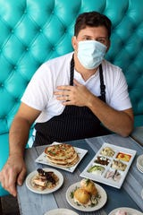 Chef/owner Constantine Kalandranis with some of his new meze plates at the Greek-ish in Harrison Oct. 8, 2020. 273 Kitchen has rebranded into a fun and casual spot with a larger selection of meze plates.