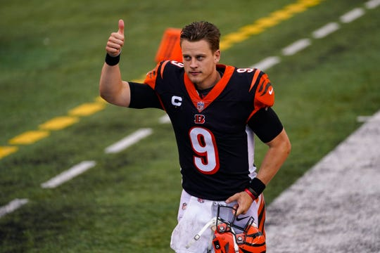 Cincinnati Bengals quarterback Joe Burrow (9) runs off the field following a 33-25 win over the Jacksonville Jaguars in an NFL football game in Cincinnati, Sunday, Oct. 4, 2020.