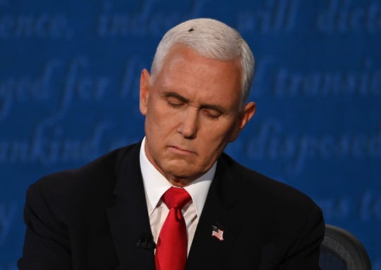 US Vice President Mike Pence takes notes during the vice presidential debate.