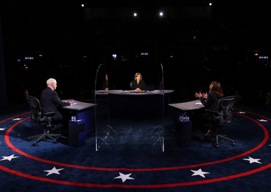 Democratic vice presidential nominee Sen. Kamala Harris (D-CA) and U.S. Vice President Mike Pence participate in the vice presidential debate moderated by Washington Bureau Chief for USA Today Susan Page.