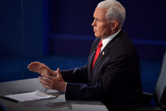 Vice President Mike Pence speaks on stage.