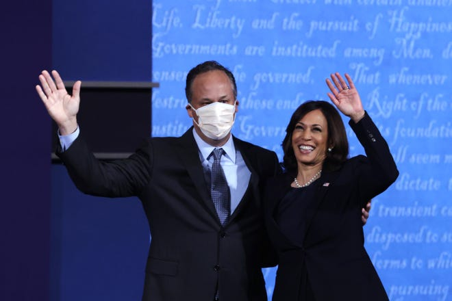Democratic vice presidential nominee Sen. Kamala Harris (D-CA) waves to crowd with husband  Douglas Emhoff after in the vice presidential debate.