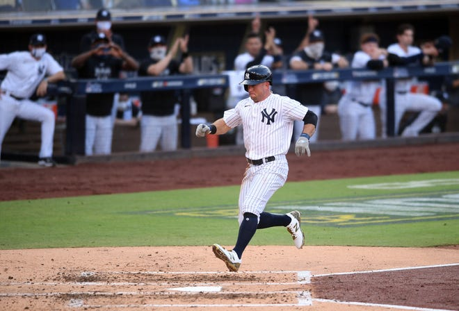 Rays-Yankees, Game 3: Brett Gardner scores on a sacrifice fly in the third inning.
