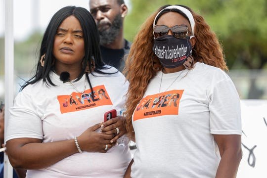 Mother of Javier Ambler, Maritza Ambler, stands with her daughter Kimberly Ambler-Jones while listening to Pflugerville City Council Member Rudy Metayer during the Pushing for Justice Caravan for Javier Ambler at San Gabriel Park in Georgetown on Saturday, August 15, 2020.