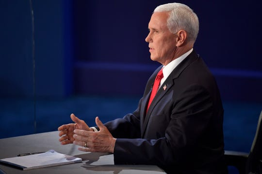 Oct 7, 2020; Salt Lake City, UT, USA; Vice President Mike Pence speaks on stage during the Vice Presidential debate between Republican nominee Vice President Mike Pence and Democratic nominee Sen. Kamala Harris held at Kingsbury Hall at The University of Utah. Susan Page, Washington Bureau Chief for USA TODAY, is the moderator.