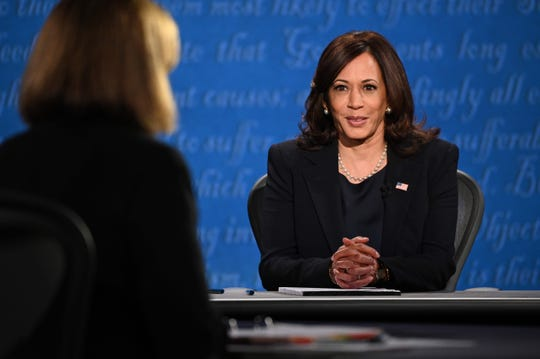 US Democratic vice presidential nominee and Senator from California, Kamala Harris arrives on stage.