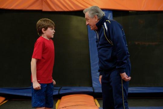 "Oakes Fegley and Robert De Niro square off in ""The War With Grandpa."""