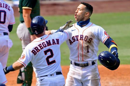 Carlos Correa celebrates his three-run homer.