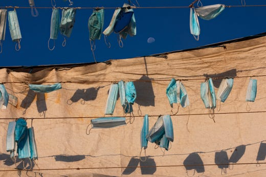 Face masks hang on a boat during a nationwide lockdown to curb the spread of the coronavirus, at the port in the mixed Arab Jewish city of Jaffa, near Tel Aviv, Israel, Wednesday, Oct. 7, 2020.
