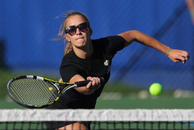 Cuyahoga Falls multi-sport athlete Emma Brustoski eyes a shot during a sectional doubles match against Wooster on Thursday.