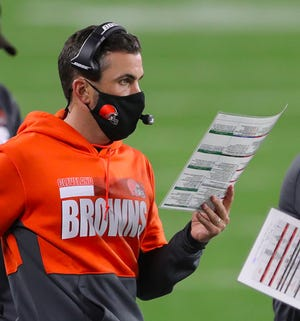Browns coach Kevin Stefanski looks over plays during the second half at FirstEnergy Stadium, Thursday, Sept. 17, 2020, in Cleveland, Ohio. [Jeff Lange/Beacon Journal]