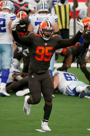 Cleveland Browns defensive end Myles Garrett (95) celebrates a turnover against the Dallas Cowboys on Oct. 4. The Browns lead the NFL with 11 takeaways. (AP Photo/Michael Ainsworth)