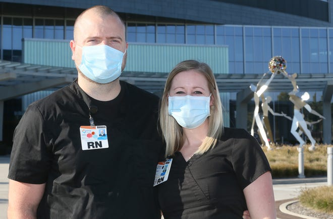 Jake and Lauren Nicholson of Rootstown both work as registered nurses at Summa Health's Akron City Hospital, often with COVID-19 patients in ICU.