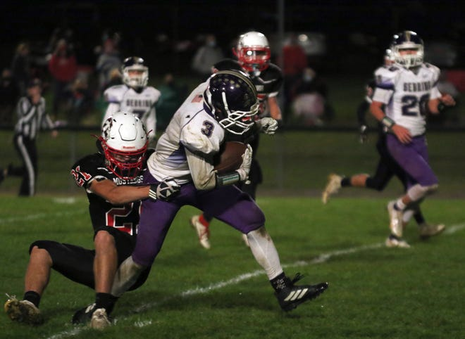 Sebring's Elijah Frederick carries Mathews' Xander Gedeon as he breaks the tackle for a 12-yard gain in the second quarter of their game on Thursday, October 8, 2020.
